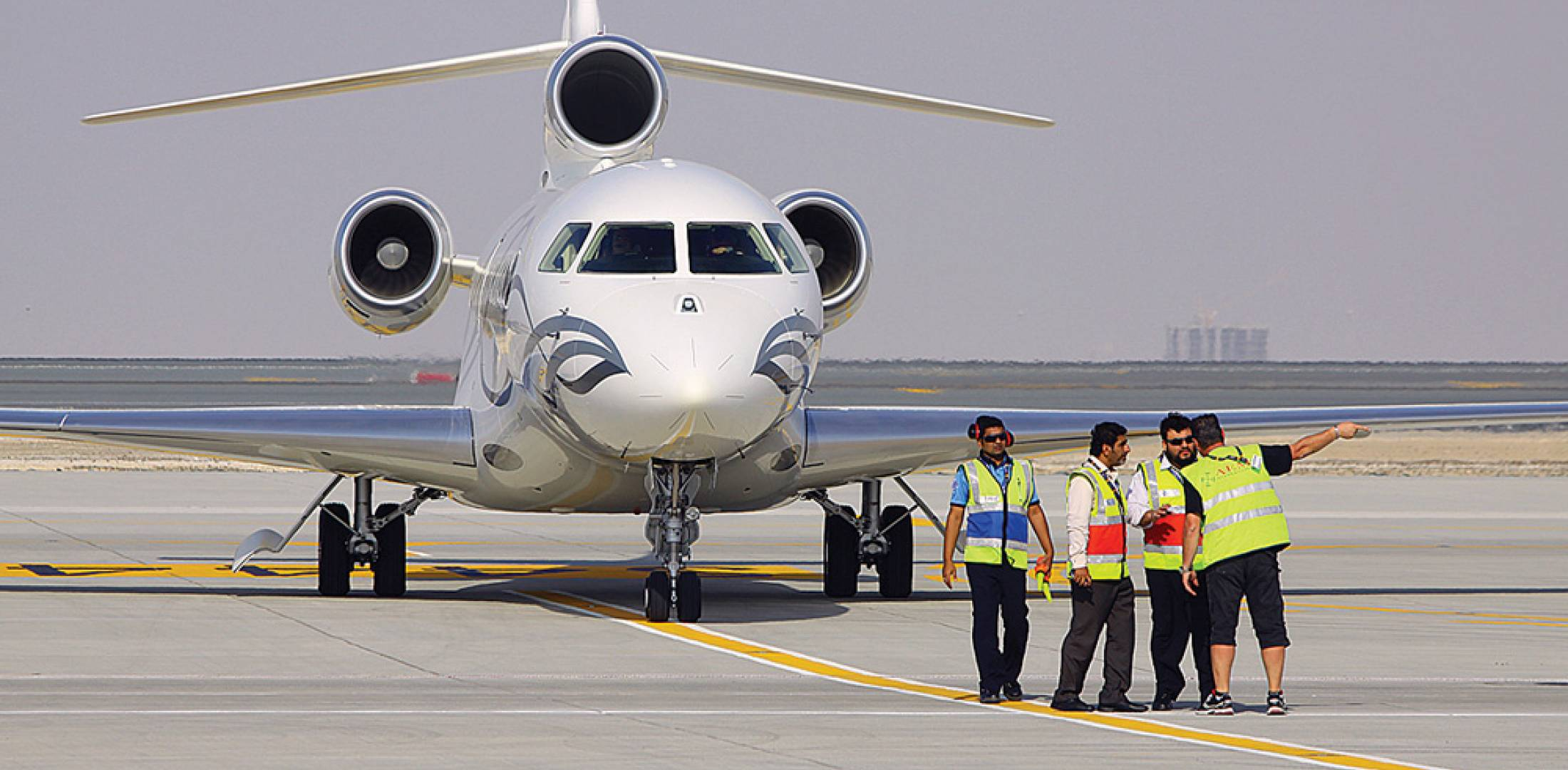 The owner of this Falcon 7X, shown here on the ramp of Al Maktoum International Airport soon after its arrival for display at MEBA, will be able to simply turn on his cellphone and start using it while in flight, if he opts to buy OnAir's mobile equipment when available in 2014.