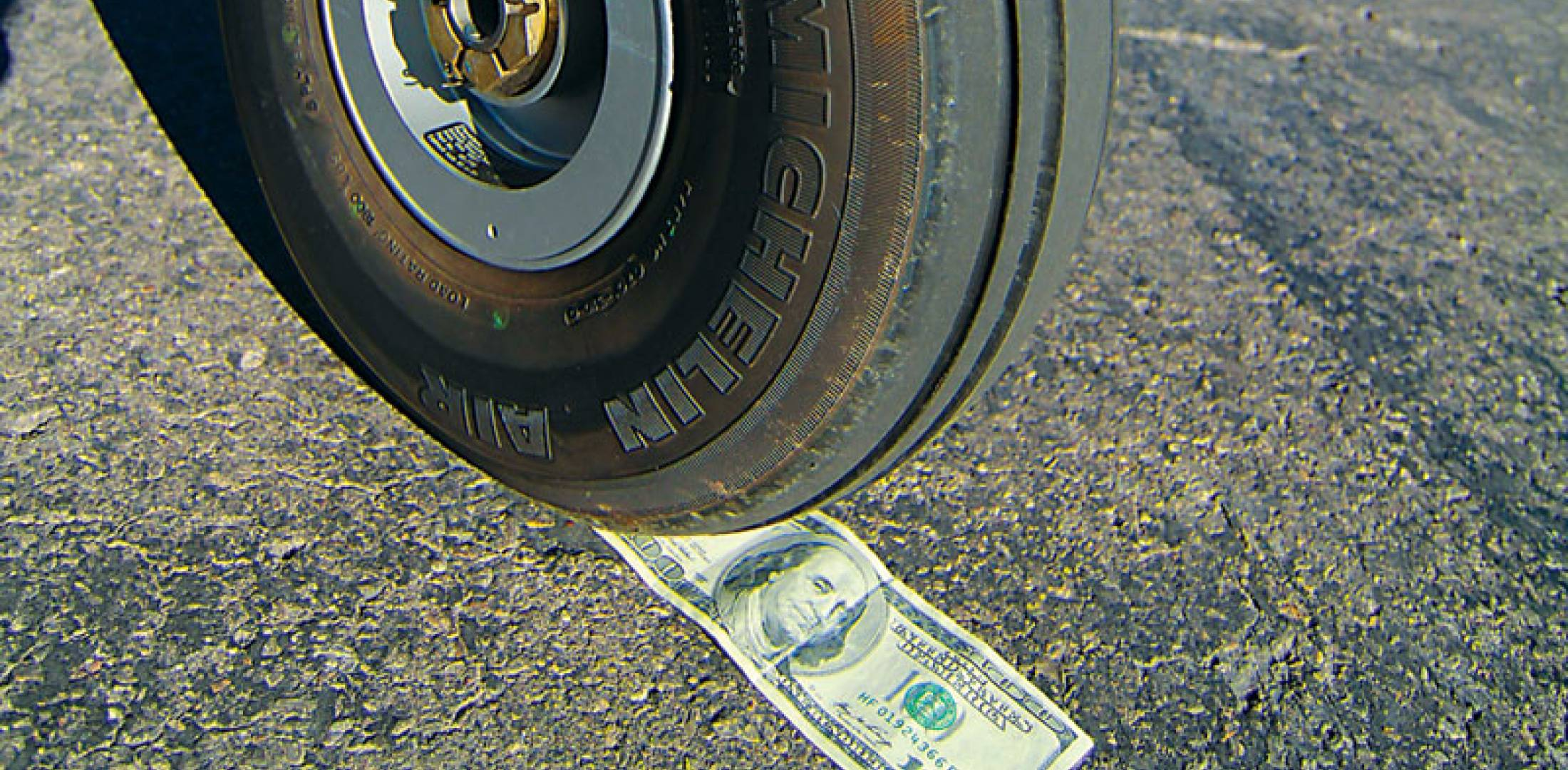 Airplane tire and $100 bill