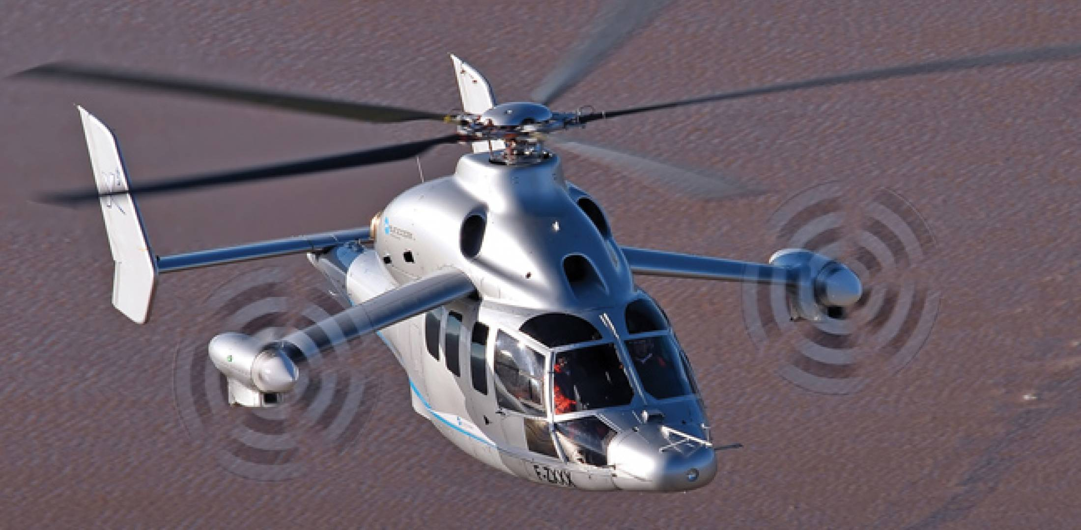 "The Eurocopter X3 technology demonstrator flew at 255 knots in level flight, an unofficial record for a helicopter, on June 7. It also reached 263 knots in a dive. ""It's no exaggeration to say that the X3 is clearly in its element at high speeds,"" said Hervé Jammayrac, Eurocopter test pilot."