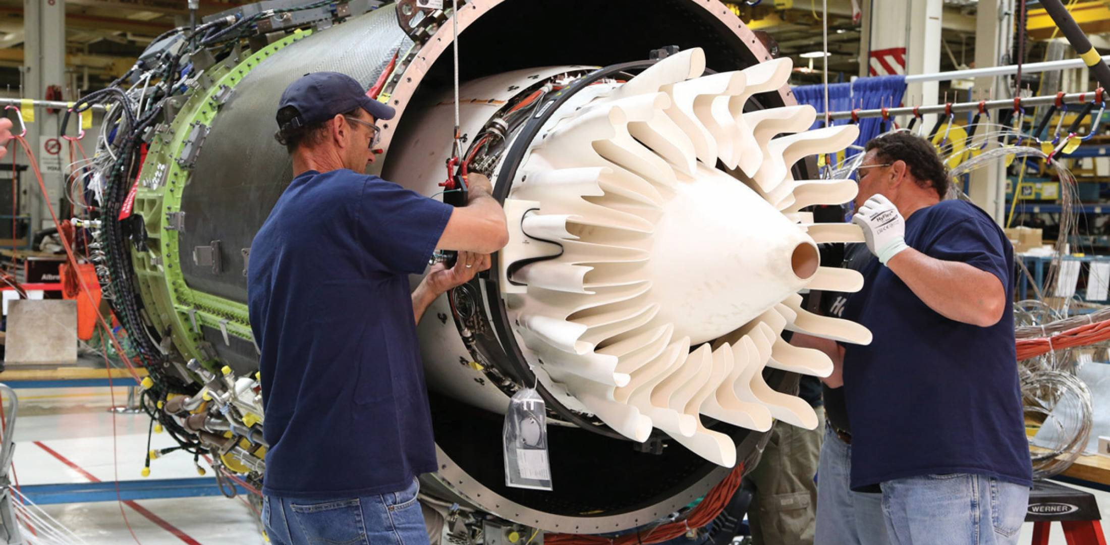GE's Passport engine marks the commercial debut of ceramic-matrix composite (CMC) material usage for harsh environment parts such as the mixer and center body assemblies. In total it uses 15 CMC parts for a weight savings of more than 40 pounds per engine.
