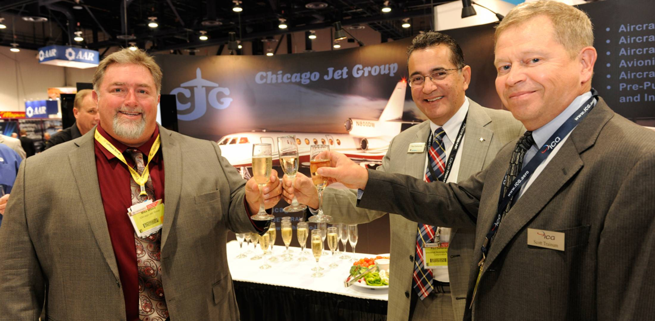 l-r: Mike Mitera, Chicago Jet Group director of operations, Paul DeHerrera, CEO of Universal Avionics, L. Scott Trainum, CEO of ICG