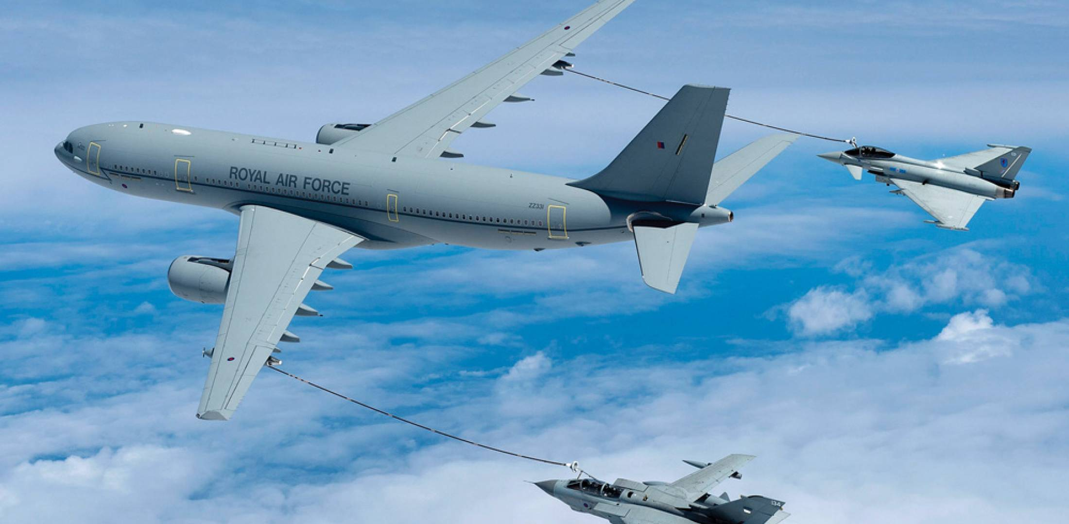 A Royal Air Force A330MRTT refuels the service's two frontline fighters–a Typhoon and a Tornado GR.4. The big Airbus tanker is known in RAF service as the Voyager. The aircraft are provided by AirTanker Ltd. as part of a unique Private Finance Initiative.
