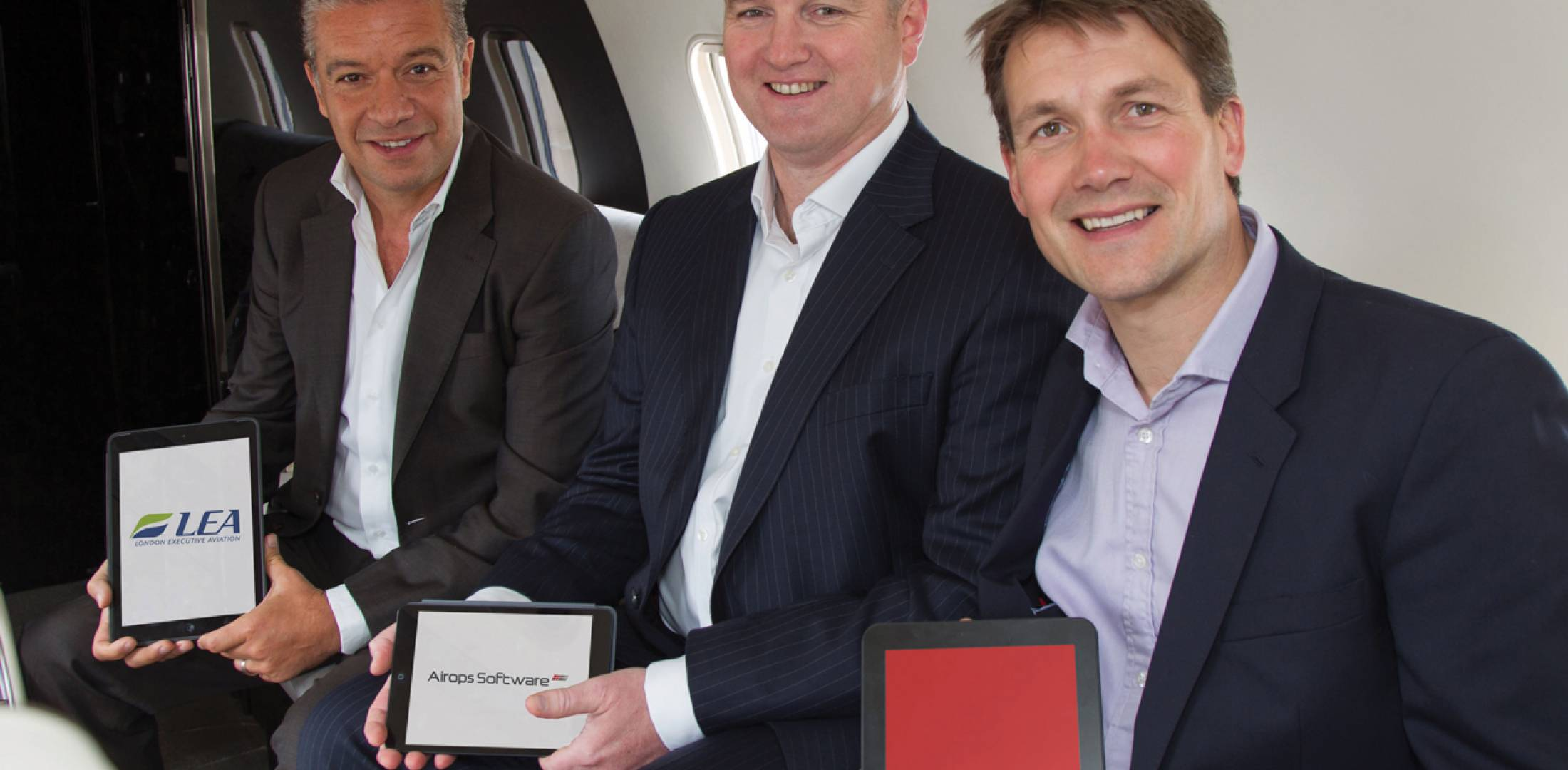 L to r: George Galanopoulos, managing director of London Executive Aviation, an Airops user; with Daniel Tee, managing director of Airops; and PrivateFly CEO Adam Twidell, celebrate the cooperation between Airops and PrivateFly.