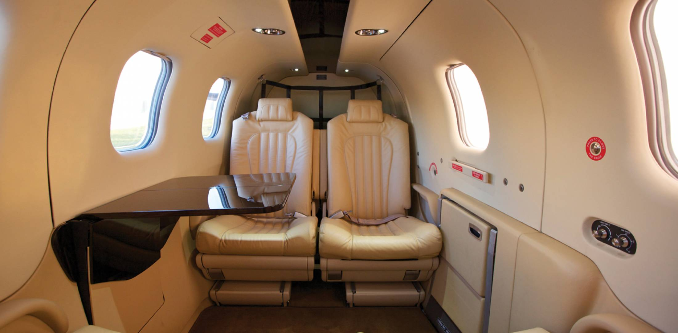 Interior options for the TBM 900 include leather seats with adjustable backrests and folding armrests, leather upper side panels and gold or brushed stainless trimming of individual fresh-air vents and reading light ring. Shown here is the Moorea sand interior.