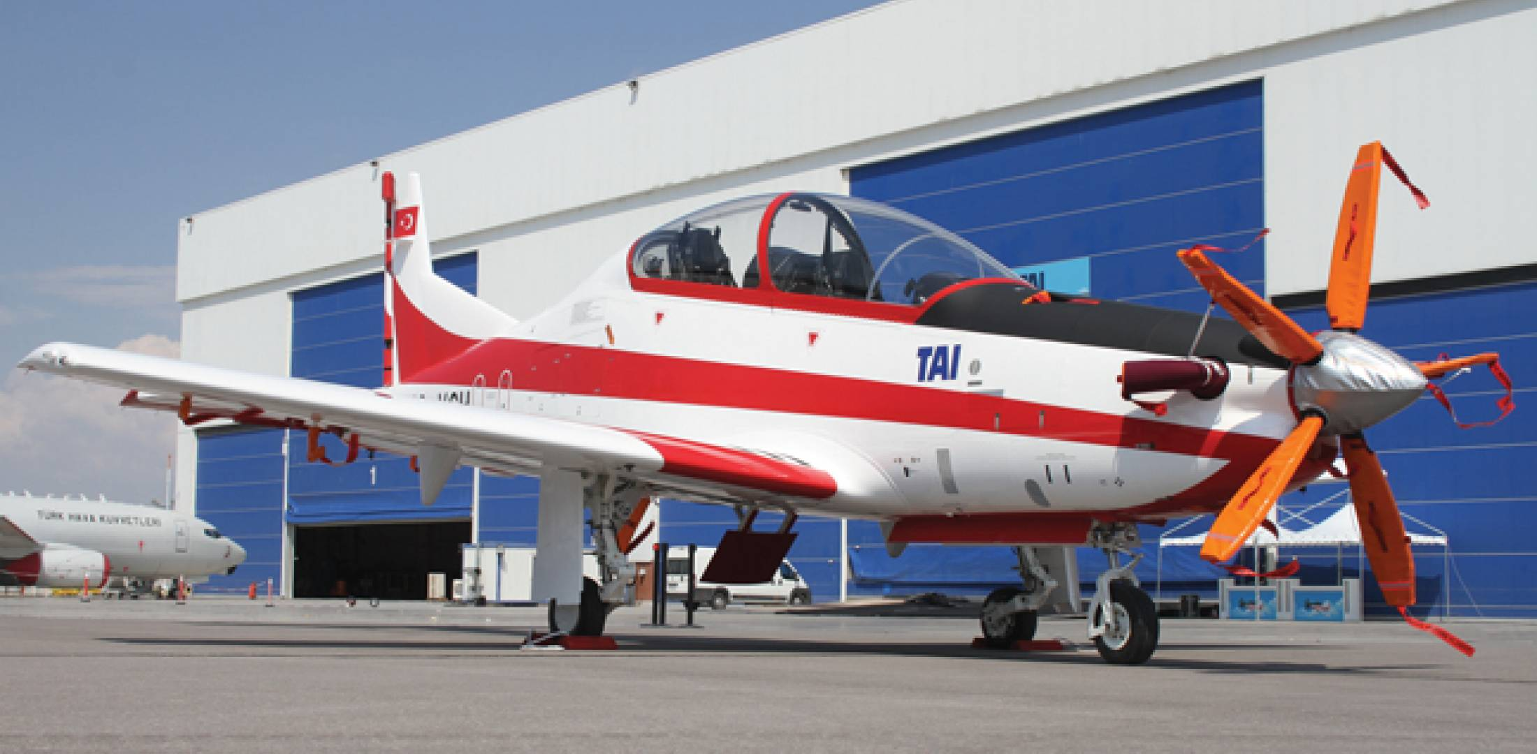 TAI's Hurkus, a tandem two-seat, low-wing, single-engine turboprop (left), is being developed as a basic trainer and ground attack aircraft for the Turkish armed forces. The prototype Hurkus, TU-VCH, made its first flight on Aug. 29, 2013, a year after it was rolled out at TAI's Ankara facility.
