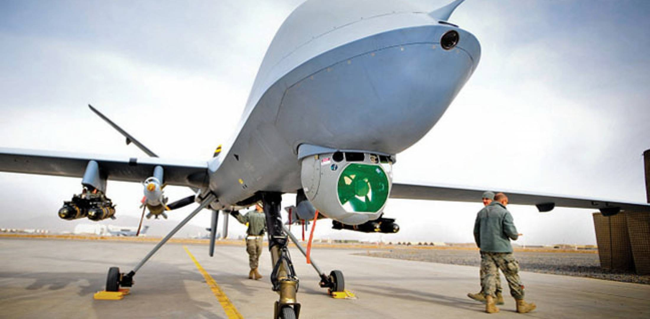 The Reaper can be armed with four Hellfire missiles and two GBU-12 laser-guided 250-pound bombs. The RAF usually flies with all four missiles, but only one bomb. The UAV's Raytheon MTS-B sensor ball and laser rangefinder/designator is beneath the nose, with the satcom antenna above.