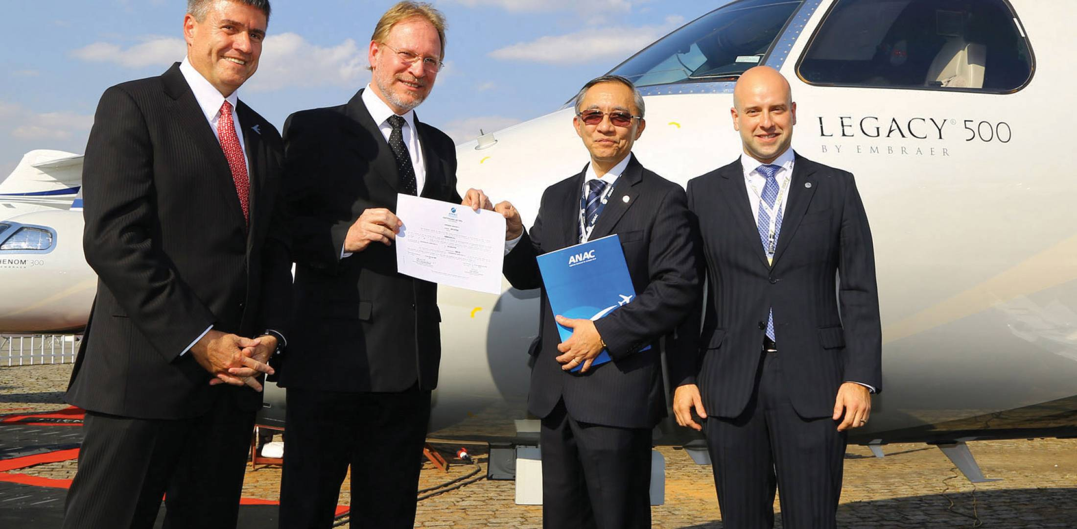Celebrating ANAC certification of the Legacy 500 are (left to right) Embraer CEO Marco Túlio Pellegrini; Mauro Kern, Embraer executive v-p of technology and engineering; and ANAC officials Dino Ishikura and Marcelo Pacheco dos Guaranys. (Photo: David McIntosh)