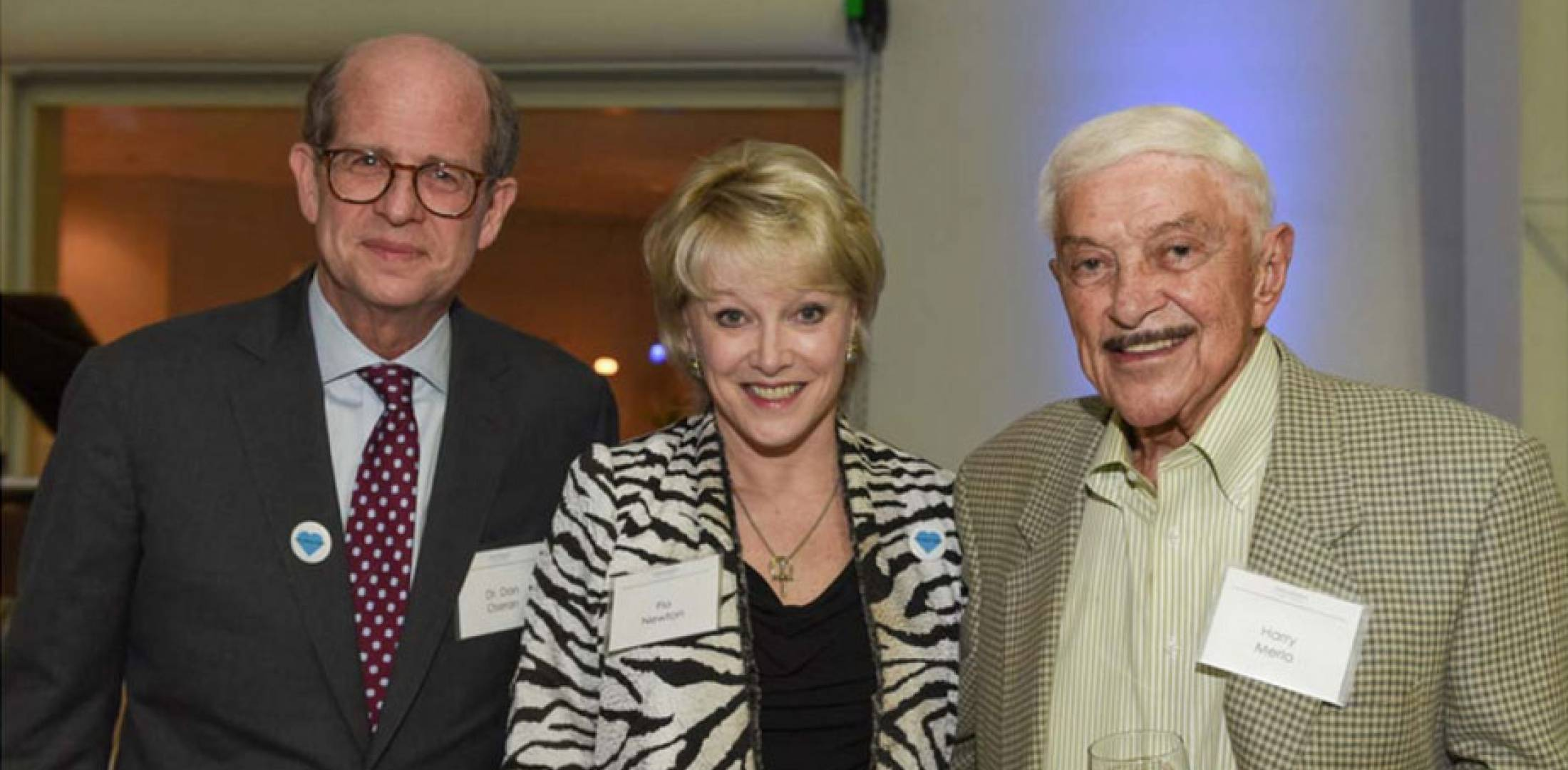 Left to right: Dr. Dan Oseran, Global Aviation founder and president Flo Newton and Harry Merlo at  Global Aviation's annual fundraising event for the Providence Heart and Vascular Institute.