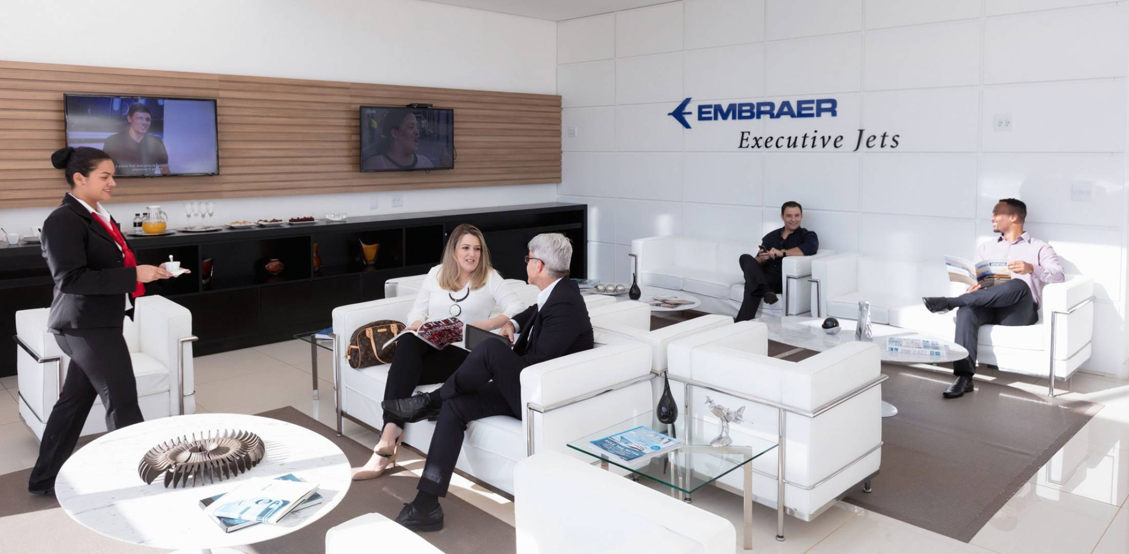 People gathered in Embraer lounge