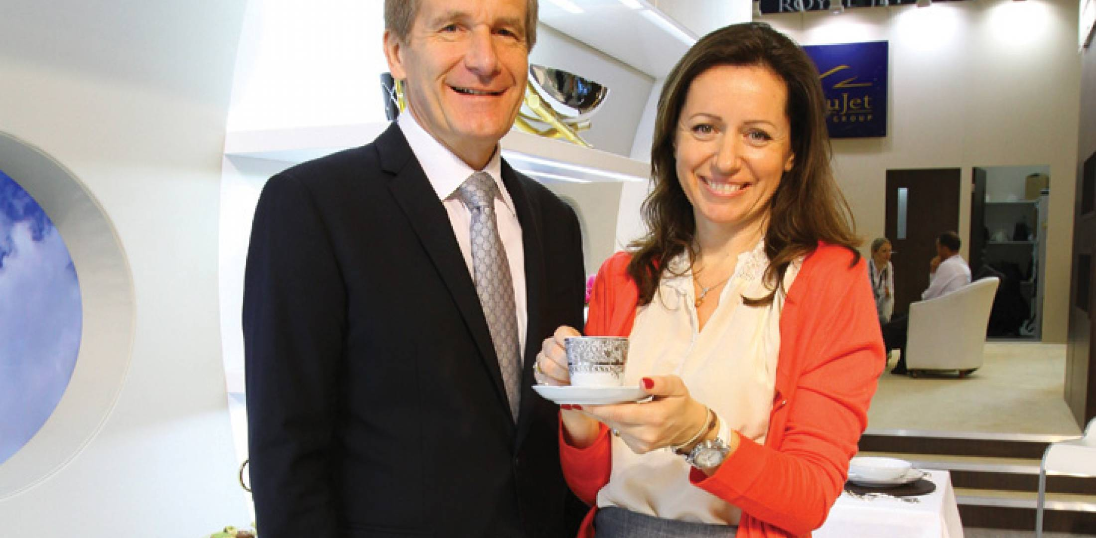 Thierry and Daniela Boutsen celebrate their company's 251st aircraft sale, and its new design department, at MEBA 2012.