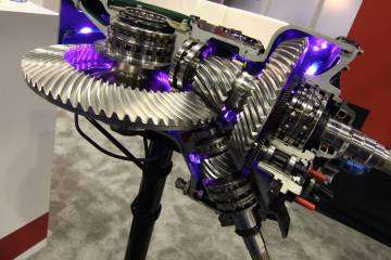 It can be tough to grasp how a helicopter can turn engine power into spinning rotors, front and rear, but this transmission at the Heli-Mart booth shows how it happens.