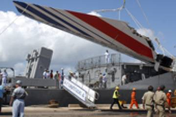 Debris from the missing Air France A330-200 recovered from the Atlantic Ocean arrives at the port of Recife, Brazil on June 14, 2009.