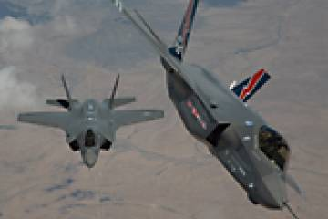 Lockheed Martin is flying the first two low-rate initial production F-35s. Th...
