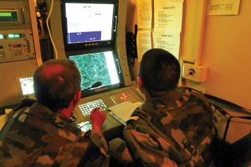 Soldiers monitor one of two consoles within the SAMP/T system radar van.