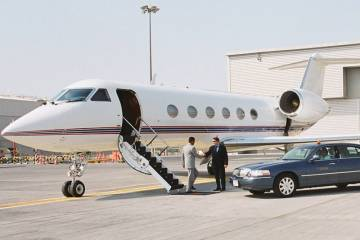 A passenger disembarking from a business jet