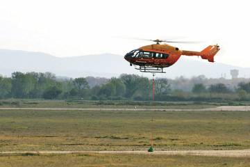 During a demo flight at Istres air force base, the unmanned EC145 performed a hover to release  a sling load.