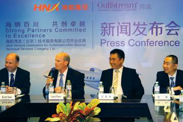Gulfstream Aerospace president Larry Flynn, second from left, announced plans for the OEM's new service center in Beijing in February last year, and by November the facility was up and running. (Photo: David McIntosh)