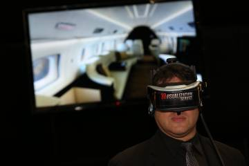 Using the system's headset takes one into an virtual aircraft cabin.