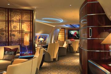 There is increasing use of curved features in the business jet cabin, and an effort to duplicate the warmth of a home-like atmosphere, as featured in this rendering by Talco Aviation.