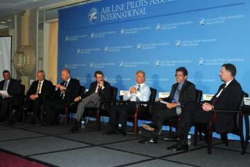 ALPA International president Lee Moak, second from right, makes a point during a discussion of NextGen funding. (Photo: Paul Lowe)