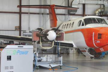 """Vector-Hawk has teamed with EcoServices to offer a version of the Pratt & Whitney-designed EcoPower Wash system for P&WC PT6 engines, shown here in the process of """"cleansing"""" a PT6 on a Beechcraft King Air."""