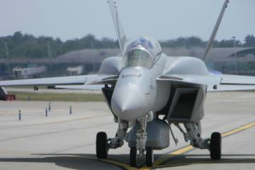 On August 27, Boeing flew the Advanced Super Hornet demonstrator for reporters and visiting delegations from Denmark and Brazil at its St. Louis facility. Visible are the Northrop Grumman conformal fuel tanks on the upper fuselage and Boeing-build centerline enclosed weapons pod.
