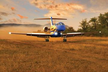 The rugged Pilatus PC-24 (above) can operate from short and unpaved runways, so may be ideal for the African market. Below: Business aircraft dominated the ramp display at the African Aerospace and Defence show held in Pretoria last year; a business aviation show is slated to be held in Marrakech next April.