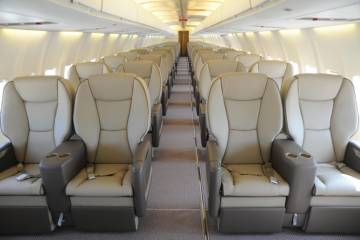 Gainjet's Boeing 737-400 features 68 executive seats, but the company is already planning further upgrades to include a bedroom and bathroom, as well as auxiliary fuel tanks and cabin connectivity and entertainment systems.