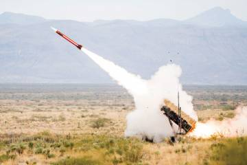 Raytheon's Patriot system has conducted around 1,000 flight tests in its history. At right, the new Modern Man Station from Raytheon enhances situational awareness for the Patriot operators. The U.S. Army has just ordered this upgrade.