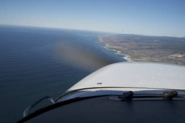 Cessna 172 over California coast