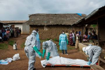 Doctors without Borders, a charity featured in BJT's Giving Back department, aids a suspected Ebola victim.
