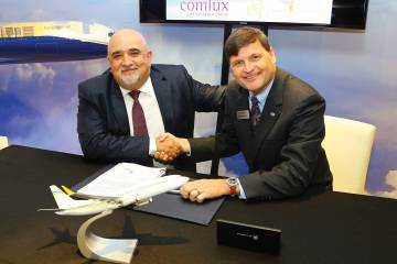 Comlux president and CEO Richard Gaona (left) signs a contract for BBJ Max 8 jets with outgoing Boeing Business Jets president Steve Taylor. The deal marks a shift for the European operator, which has mainly been an Airbus operator.  (Photo: David McIntosh)