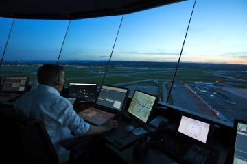 Air traffic controller on duty in Calgary tower