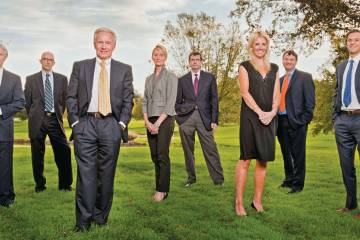 AIN's Senior Leadership, from left: R. Randall Padfield, Anthony T. Romano, Wilson S. Leach, Jane Webb, John F. McCarthy, Jr., Jennifer Leach English, Charles Alcock and David Leach