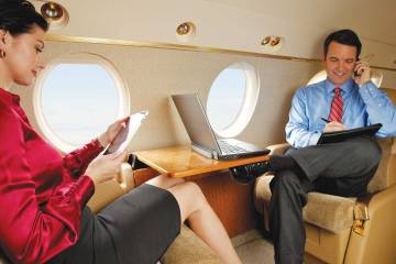 Two passengers using mobile devices.