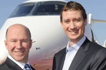 Bombardier president and CEO Alain Bellemare and NetJets chairman and CEO Jordan Hansell