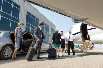 Passengers boarding a business jet.