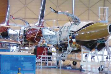 Left, the TBM 900 assembly line in Tarbes. Below, a fuselage awaits mounting of the PWC PT6. The aircraft was announced in April 2014; the 100th copy will be delivered next month.