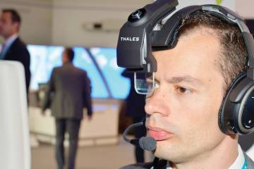 Thales is offering demonstrations of its head-worn TopMax HUD on a Bose noise-canceling headset.