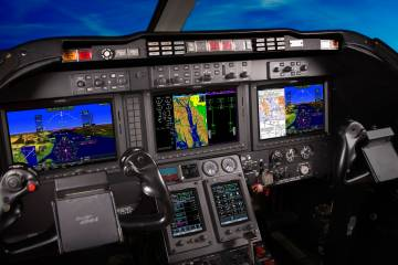 With three 12-inch landscape monitors and a pair of GTC 570 touchscreen controllers, Garmin's G5000 flight deck is on pace for approval in the upgraded Beech/Hawker 400.