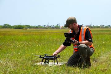 Lone Star UAS Center pilot readies quadcopter for flight