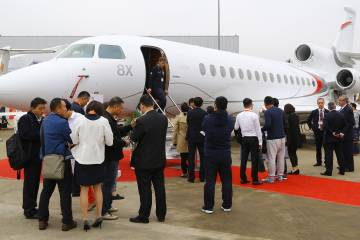 Paris, New York, Abu Dhabi and Shanghai were the ports of call for Dassault's Falcon 8X demonstrator. Shown here at the ABACE show in China, the trijet is expected to boost Dassault's business jet revenue when it enters service. Photo: Dave McIntosh