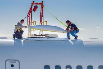 Technicians install the dome above Honeywell's JetWave system under an FAA supplemental type certificate.