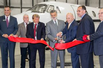 The ribbbon cutting at Signature's new Cleveland FBO.Just in time for the Republican National Convention to hit Cleveland later this month, Signature Flight Support opened its new FBO at the city's Burke Lakefront Airport, where it is the lone services provider.  The new $9 million facility occupies four acres adjacent to the BBA Aviation subsidiary's old FBO, which will be retained and used for tenant offices.  It's 6,000 sq ft terminal with a design reflective of the city's history as an industrial center