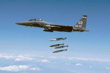 F-15 fighter releases multiple JDAM