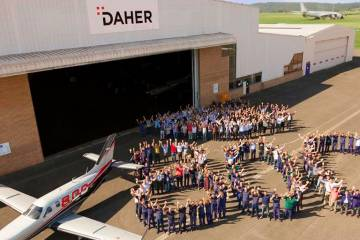 "Bon Voyage! The production crew at Daher's factory in Tarbes, France, form a ""figure 800"" to celebrate the 800th TBM to emerge from the factory. The TBM 930, Daher's latest iteration of the 25-year-old design, produces 850 shp and scoots along at 330 knots with a range of 1,730 nm."