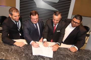 L-R: Jet Aviation senior v-p MRO and FBO EMEA and Asia Stefan Benz, Zetta Jet managing director Geoffrey Cassidy, Jet Aviation president Robert Smith and Zetta Jet director of maintenance Joe Ponce sign the agreement at NBAA 2016.