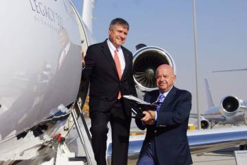 Marco Tulio Pellegrini, president and CEO, Embraer Executive Jets (left), with Fouad Fawaz, chairman and CEO, Cedar Executive. PHOTO: DAVID McINTOSH