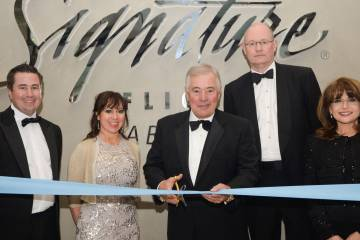 Cutting the ribbon at the grand opening of Signature's new Luton FBO