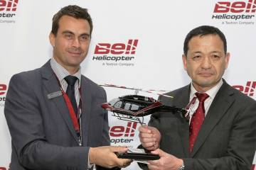 Bell executive v-p of commercial sales Patrick Moulay and a representative from Nakanihon Air Service sealed a deal for two Bell 429s here at Heli-Expo on Tuesday.